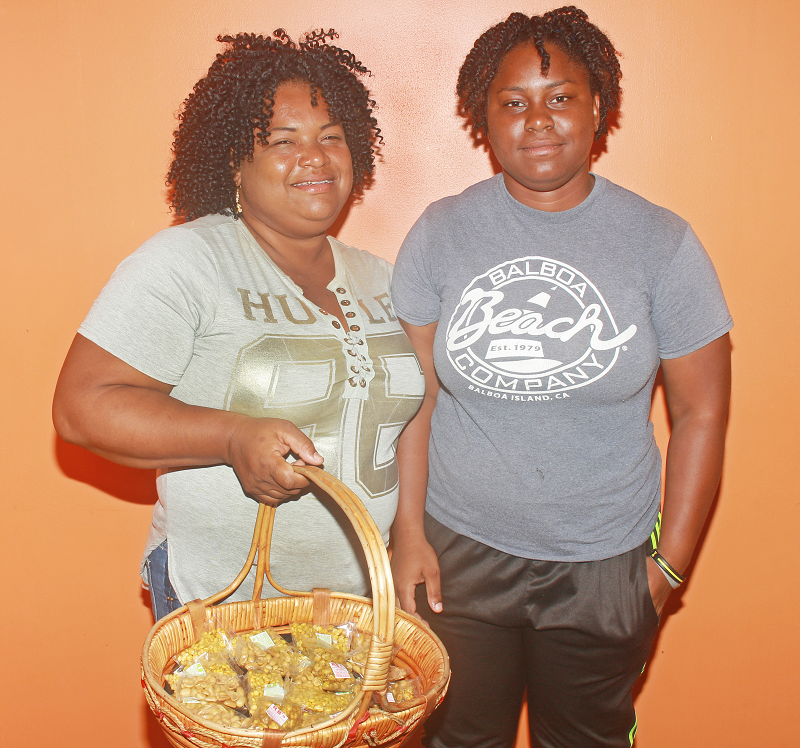 Nakeisha Simon, left, and daughter Makeisha Simon, 21 are selling nuts to raise funds after Makeisha was accepted to UWI for a bachelor's degree in medicine and surgery starting in September.