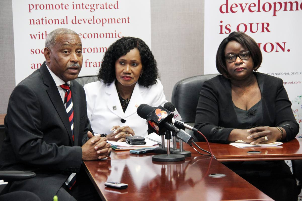 In this 2017 file photo, Keston Nancoo, chairman of the Employers' Consultative Association, responds to a question at a news conference following the meeting of the National Tripartite Advisory Council (NTAC) at the Eric Williams Financial Complex, Port of Spain. Looking are Labour Minister Jennifer Baptiste-Primus and NTAC Chairman,  Camille Robinson-Regis.