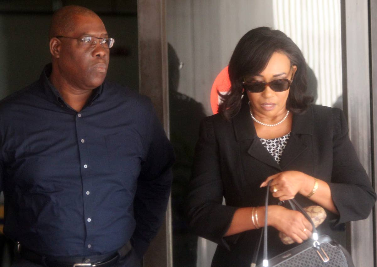 LEAVING COURT: Former High Court judge Marcia Ayers-Caesar and her husband Rickie were in the Hall of Justice yesterday for continuation of her case against Chief Justice Ivor Archie. FILE PHOTO