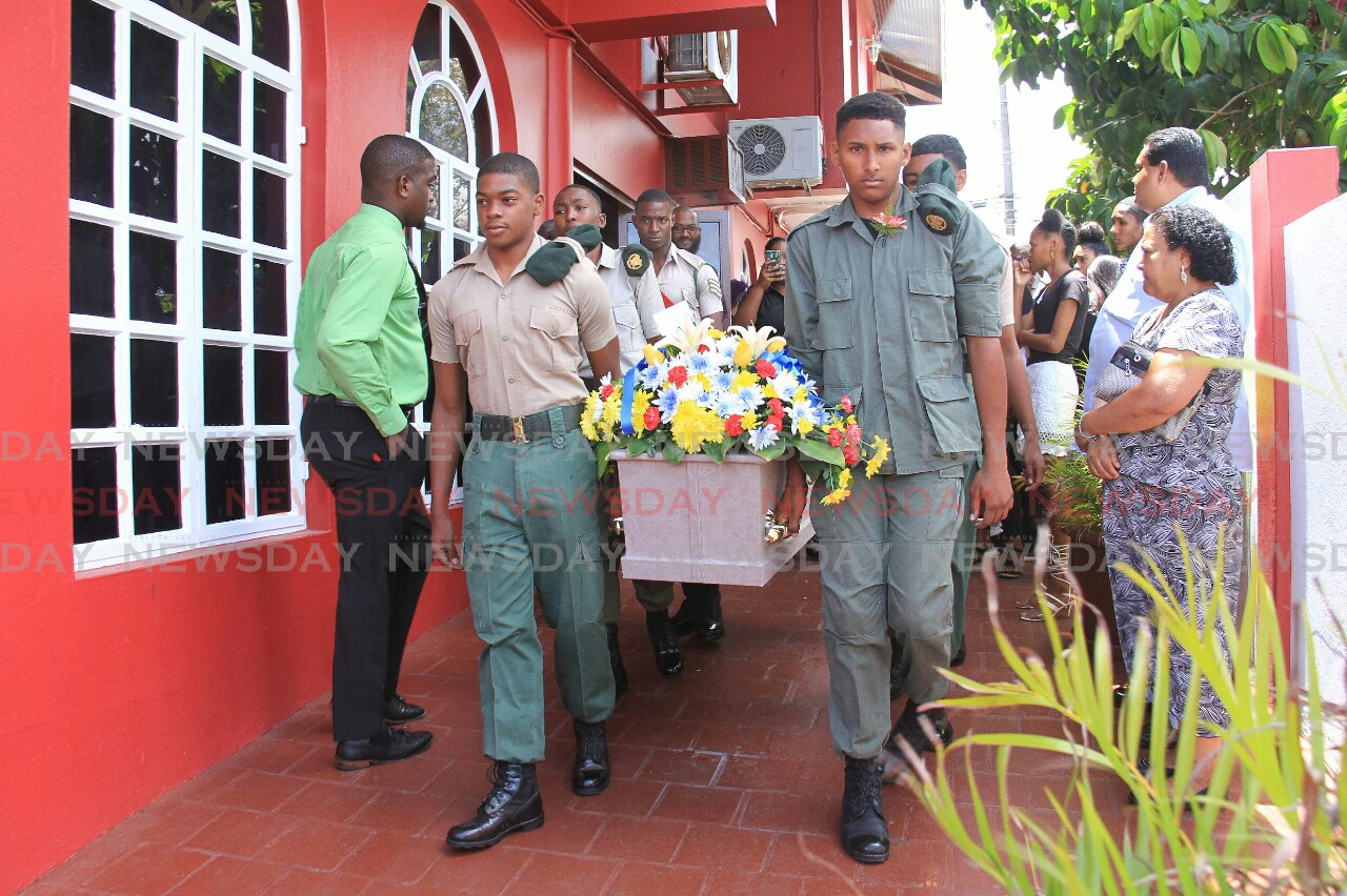 members of the TT Cadet Force carry out the body of Tyrek Richardson at K Allen and Sons Funeral Chapel, Arima.  Photo: Ayanna Kinsale