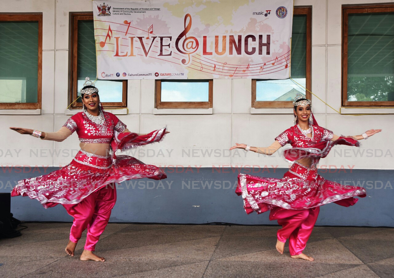 Shiv Shakti dancers perform at the Ministry of Community Development Culture and the Arts Live@Lunch Masala at the National Library.  Photo: Kerwin Pierre