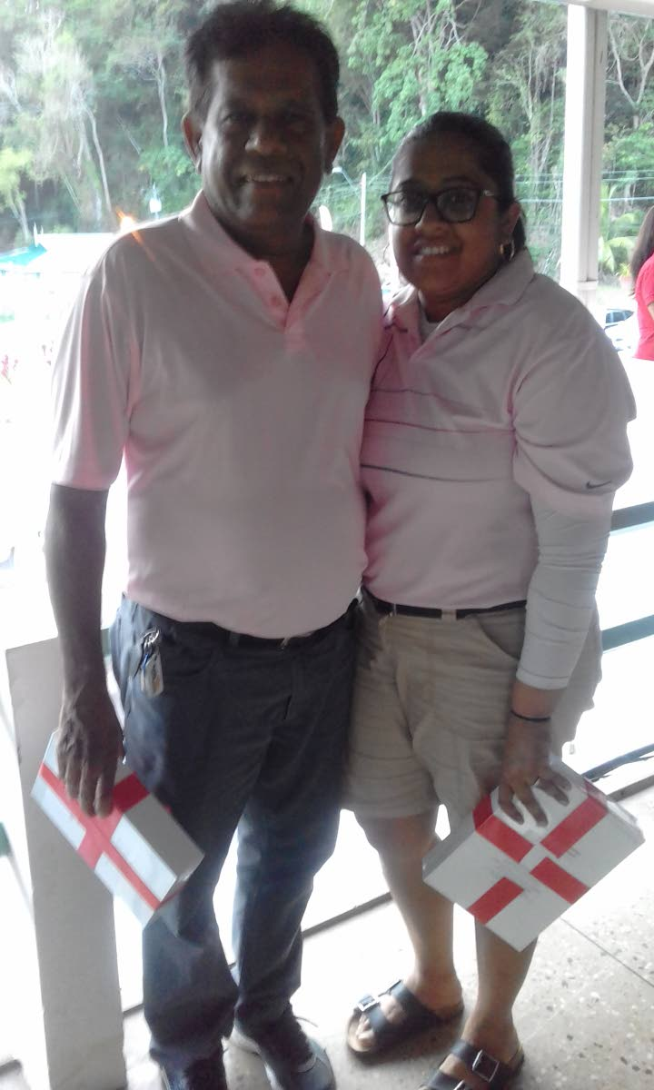The father and daughter team of Takoor and Deana Ramnath, sponsored by Trinidad Newsday, at the St Andrew's Golf Course, Moka, Maraval after winning the 19th annual Scotiabank Foundation Charity Golf Tournament last year. PHOTO BY JOEL BAILEY