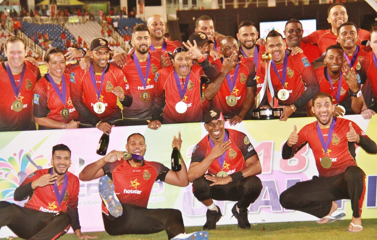 The Trinbago Knight Riders pose with their medals after beating the Guyana Amazon Warriors, in the 2018 Hero CPL final at the Brian Lara Academy, Tarouba.