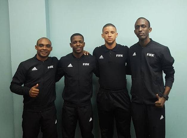 Caleb Wales (right) and Joseph Bertrand (left) with other oficials during an April 2018 international match between TT and Panama at the Ato Boldon Stadium, Couva.