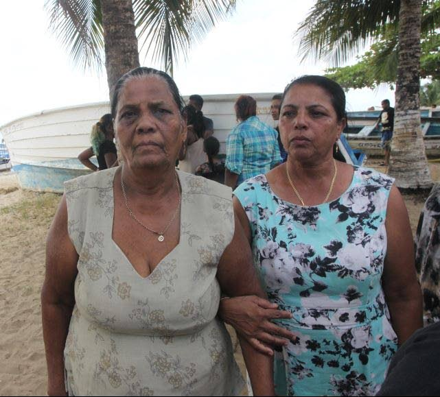 STILL WAITING: Etwaria Gyandass,74, left still waiting for her son Siewnarine a month after he disappeared at sea after a boating mishap.  FILE PHOTO