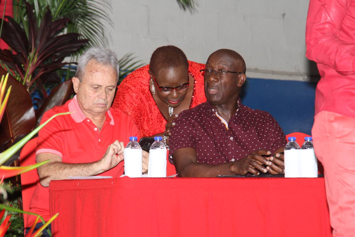 PNM chairman and Finance Minister Colm Imbert, Planning and Development Minister Camille Robinson-Regis and Prime Minister Dr Keith Rowley during a PNM meeting at Barataria South Secondary School on April 16. Imbert and a PNM team will meet the EBC this week to discuss local government and general elections. FILE PHOTO