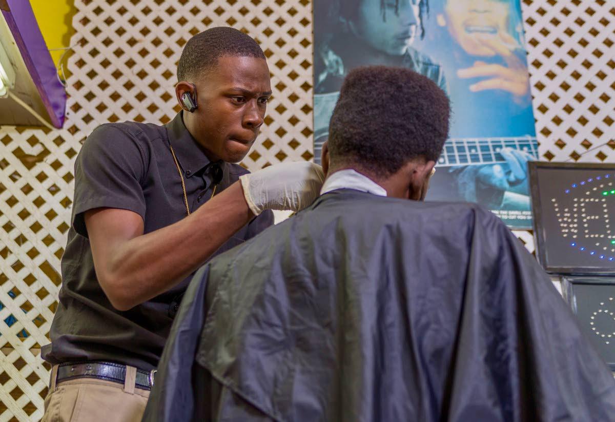 Tobago teenage Javanne Williams is in demand for his haircuts.