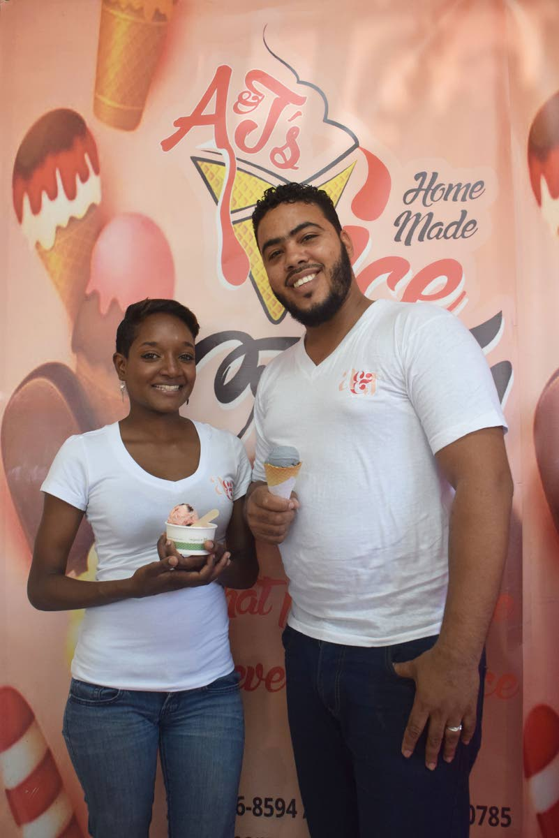 Anthony Henry and his wife June-Ann, owners of A&J Homemade Ice Cream, offer two of their signature flavours, Strawberry Medley and Dark Vanilla, at their Chaguanas store.
