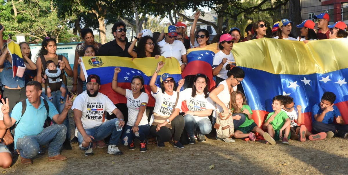 File photo: Venezuelans living in TT stage a rally ealier this month near their home embassy in support of Venezuela's National Assembly president Juan Guaido.