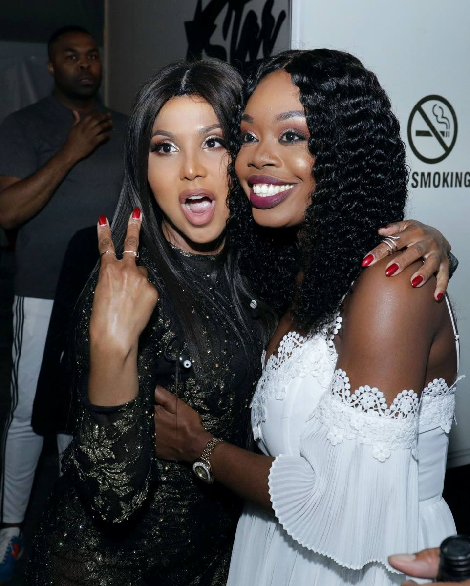 R&B sensation Toni Braxton, left, and Secretary for Tourism and Culture Nadine Stewart-Phillips at the Tobago Jazz Experience International Night at Pigeon Point Heritage Park on Sunday.