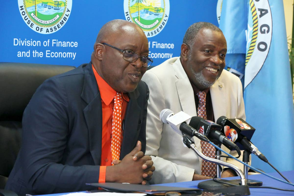 Chief Secretary Kelvin Charles and George Leacock, chairman of the Tobago Festivals Commission speaking to the media at last week's post Executive Council media briefing.