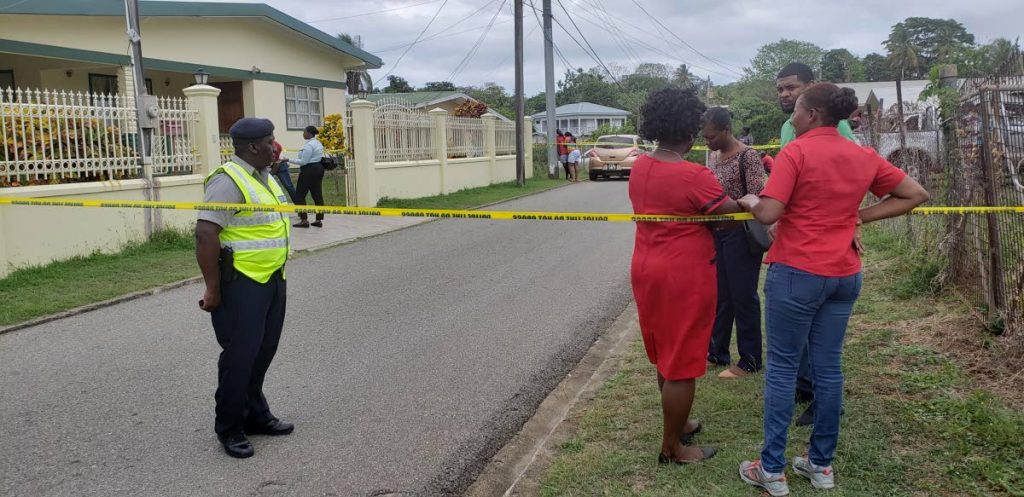 "Police block of Cocrico Ave in Bucco, around the home of John ""Joker"" Mills, 70, and his common-law wife Eulyn John after the couple was discovered brutally murdered at the house yesterday."