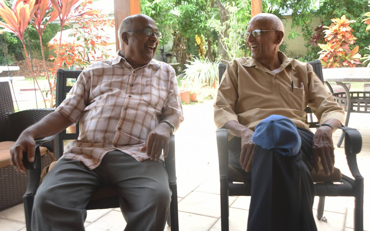 Heritage Communications chairman Hans Hanoomansingh, left, and geneaologist Shamshu Deen chat about the history of Indian indentured immigrants at Hanoomansingh's home in Valsayn. PHOTOS BY KERWIN PIERRE
