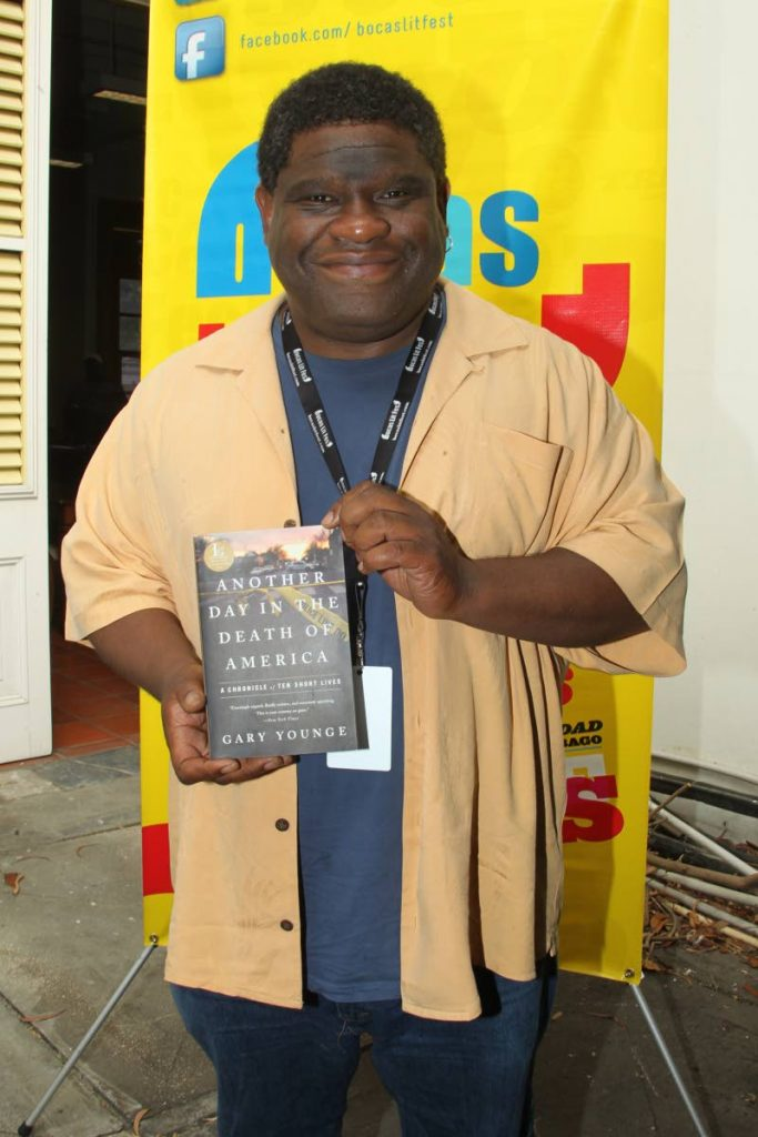 Gary Younge, British writer and UK Guardian editor at large, with a copy of Another Day in the Death of America in which he chronicles the gun-related deaths of ten American teens.  PHOTO BY ROGER JACOB.