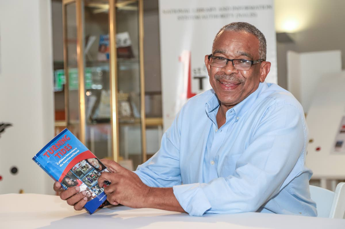 Ian Randle of Ian Randle Publishers Ltd with one recent release, Turning Tides: Caribbean Intersections in the Americas and Beyond at the National Library, Abercromby Street, Port of Spain.