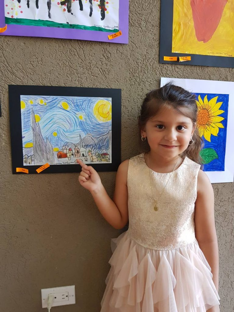 Emma Henderson stands next to her replica of Vincent Van Gogh's Starry Night.