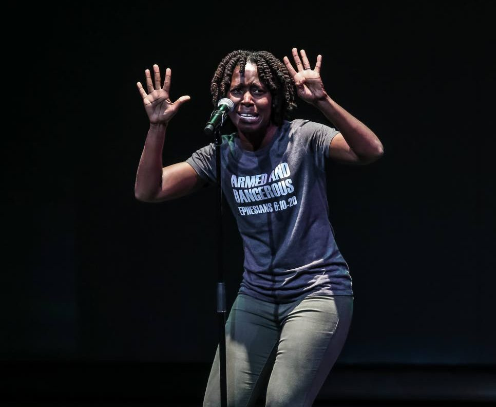 Crystal Skeete-St Hillaire during her performance at the First Citizens National Poetry Slam finals on Sunday at NAPA in Port of Spain.    PHOTOS BY JEFF K MAYERS