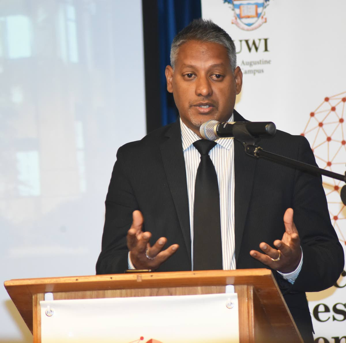 Agriculture Minister Clarence Rambharat speaks at the opening ceremony of the 2019 cocoa symposium at UWI on Wednesday. PHOTO BY KERWIN PIERRE