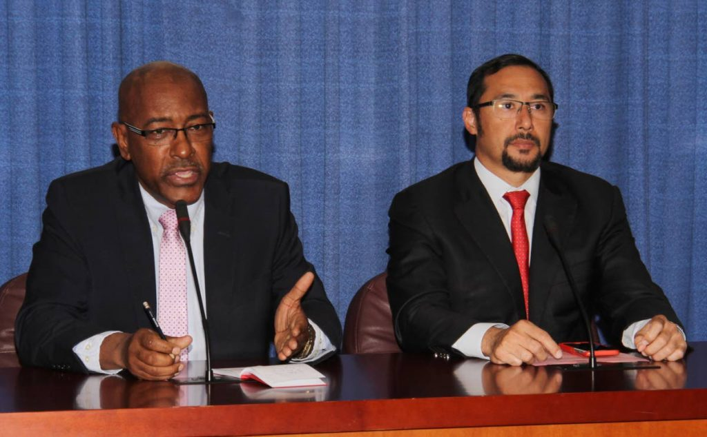 Communications Minister Stuart Young, right, and Minister of Public Utilities Robert Le Hunte, at Thursday's post-Cabinet media briefing at the Diplomatic Centre, St Ann's, Port of Spain.