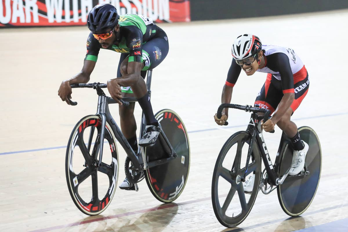 Overall winner Akil Campbell of PSL (left) approaches the finish line ahead of U-23 winner and overall runner-up Kemp Orosco (DPS) in the National Cycling Championships scratch final at the National Cycling Centre, Couva on Thursday. PHOTO BY ALLAN V CRANE/CA-images
