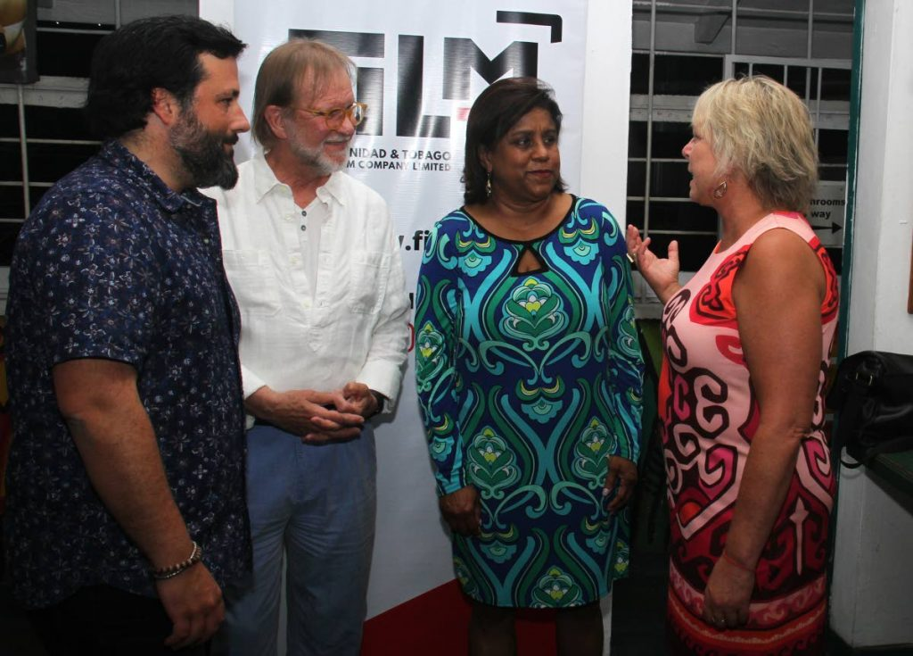Minister of Trade and Industry Paula Gopee-Scoon, second from right, has a conversation with film location managers, from left, ) Eduardo Rodrigalvarez of London, Dow Griffith of Los Angeles and Christine Bonnem of Atlanta at a reception held at Veni Mange restaurant, Ariapita Avenue, Woodbrook, on Friday.