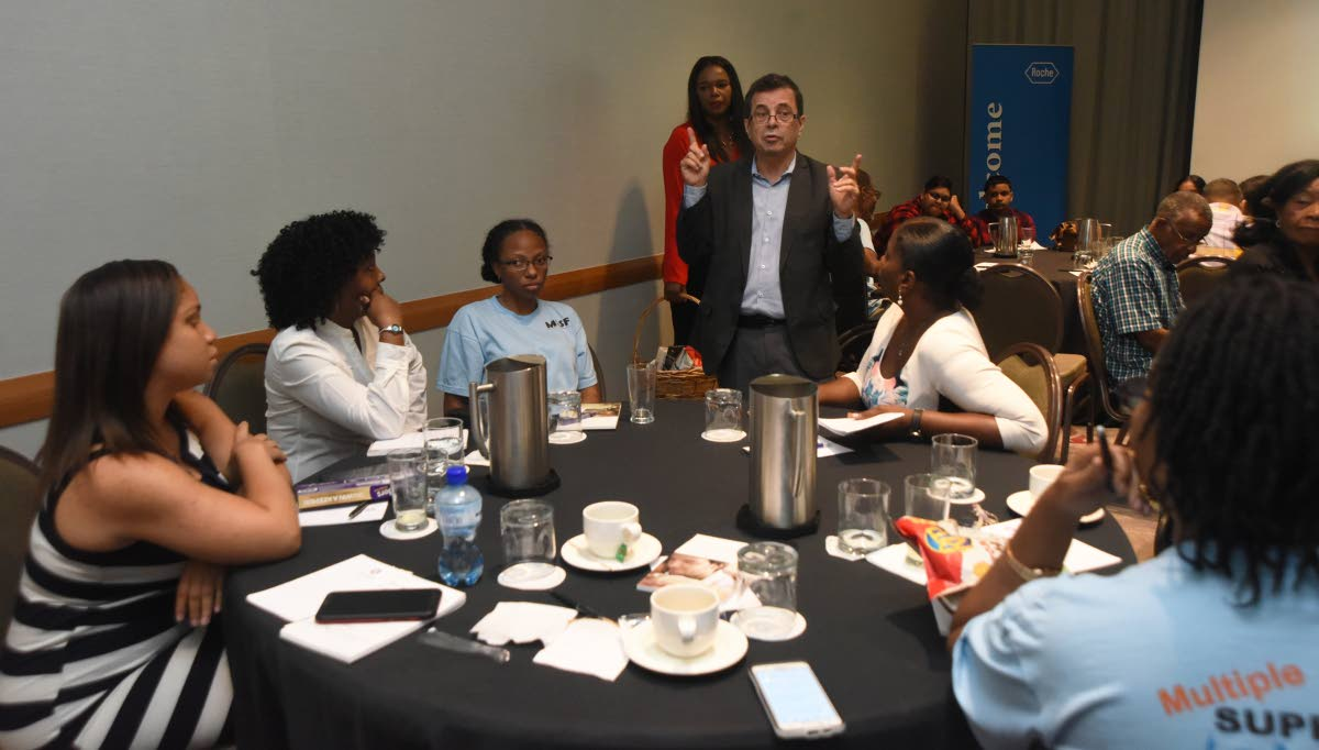 Multiple sclerosis patients, relatives and members of a support group listen to Dr Arnolodo Soto during a seminar at Hyatt Regency, Port of Spain on April 30.