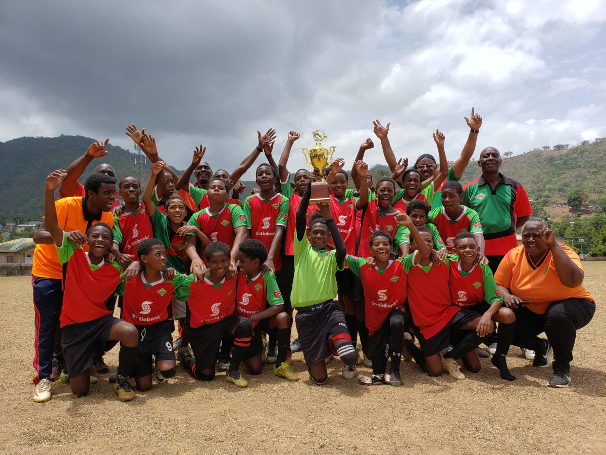 Jabloteh U-13 players, coaches and management team celebrate their 5th straight Youth Pro League title on Saturday.