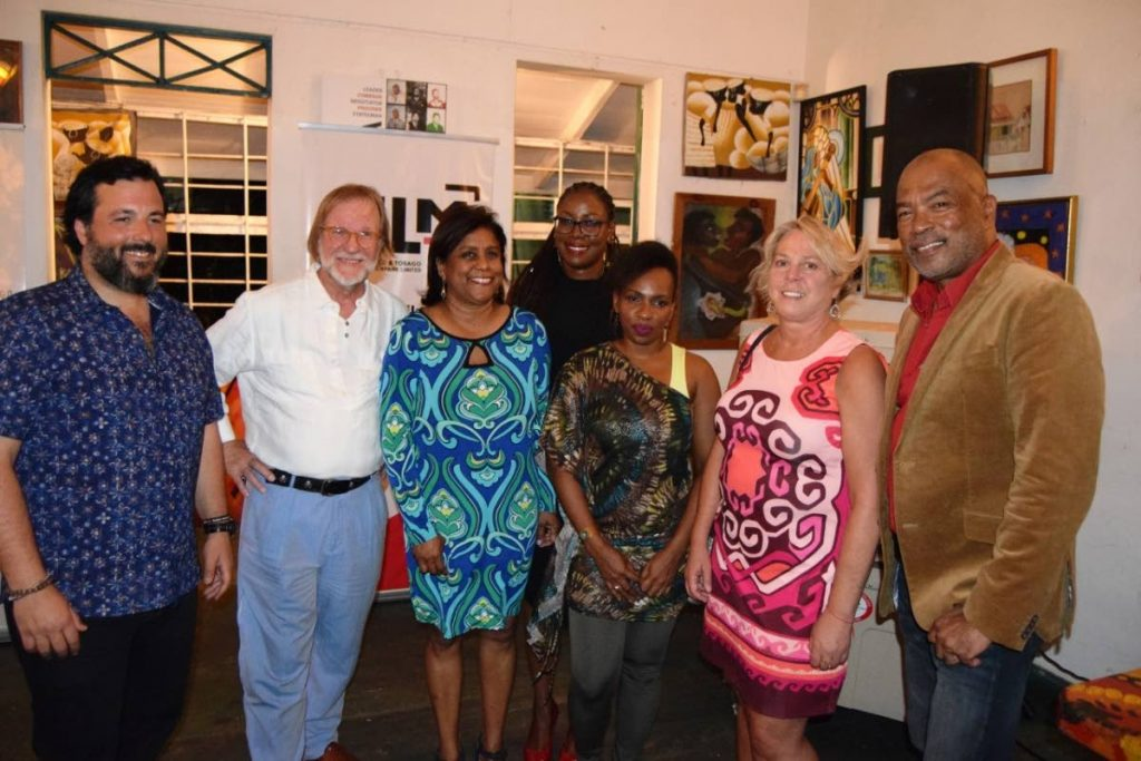 Trade Minister Paula Gopee-Scoon, third from left, with Calvin Bijou chairman, CreativeTT, right; Dionna Mc Nicol-Stephenson, chairman, FilmTT, third right; Nneka Luke, general manager, FilmTT, back; and location managers.