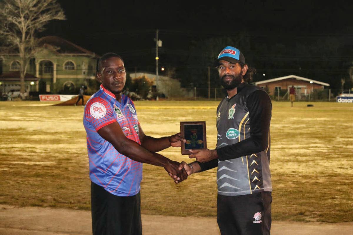 HKL Aranguez' Rishard Harris ,left, receives the man of the match award from national player Imran Khan after his side beat South Boys All Stars by eight wickets, in the Central Super League match recently.