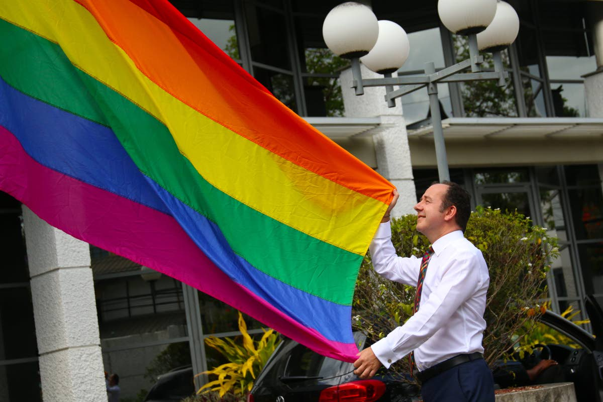 High Commissioner Tim Stew MBE raises the Rainbow Flag on IDAHOBIT 2019 at the British High Commission  Photo source: British High Commission