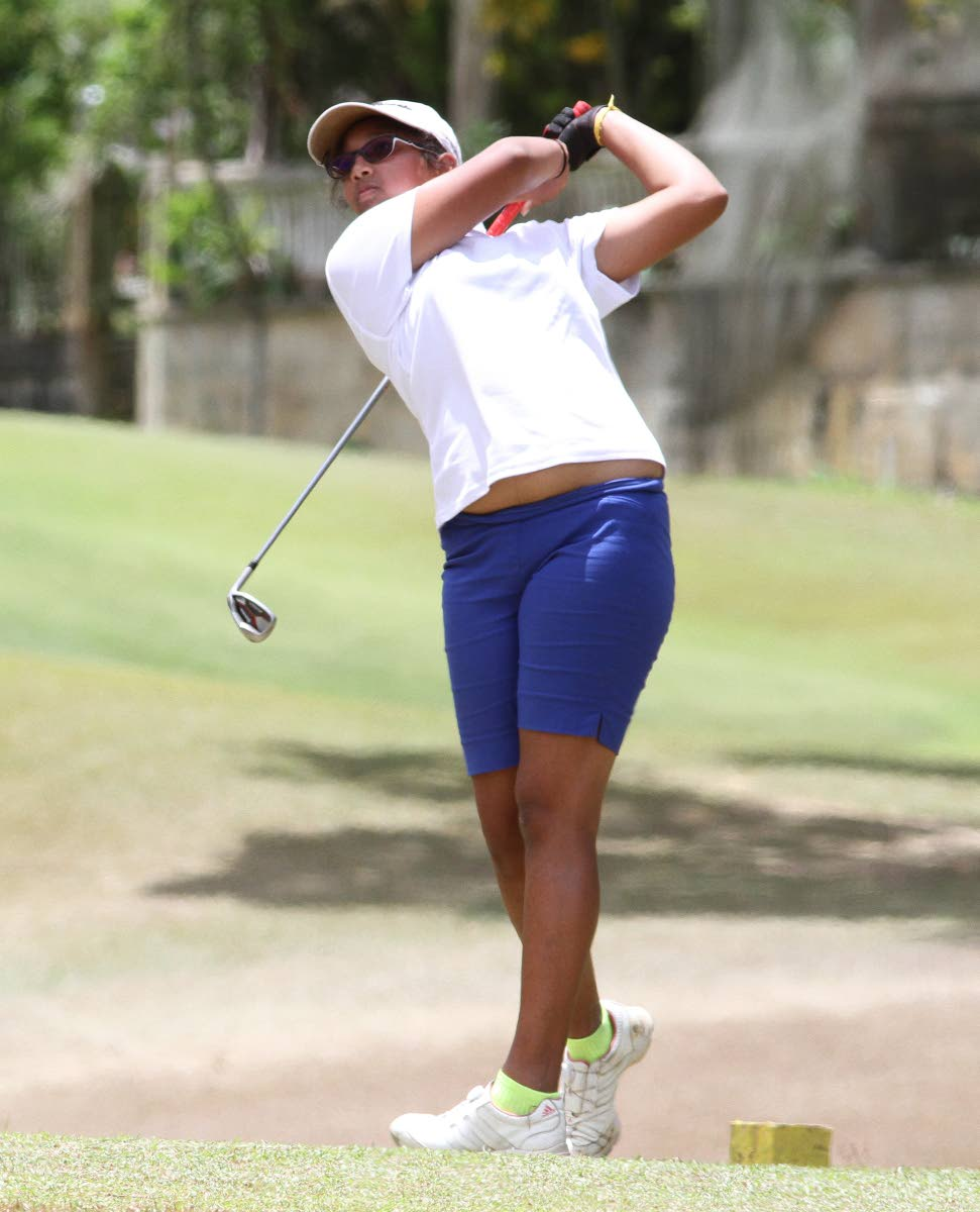 Chloe Ajodha tees off on the fifth hole, during yesterday's Scotiabank Charity Golf Tournament, at the St Andrew's Golf Course, Moka, Maraval. PHOTO BY ANGELO M MARCELLE
