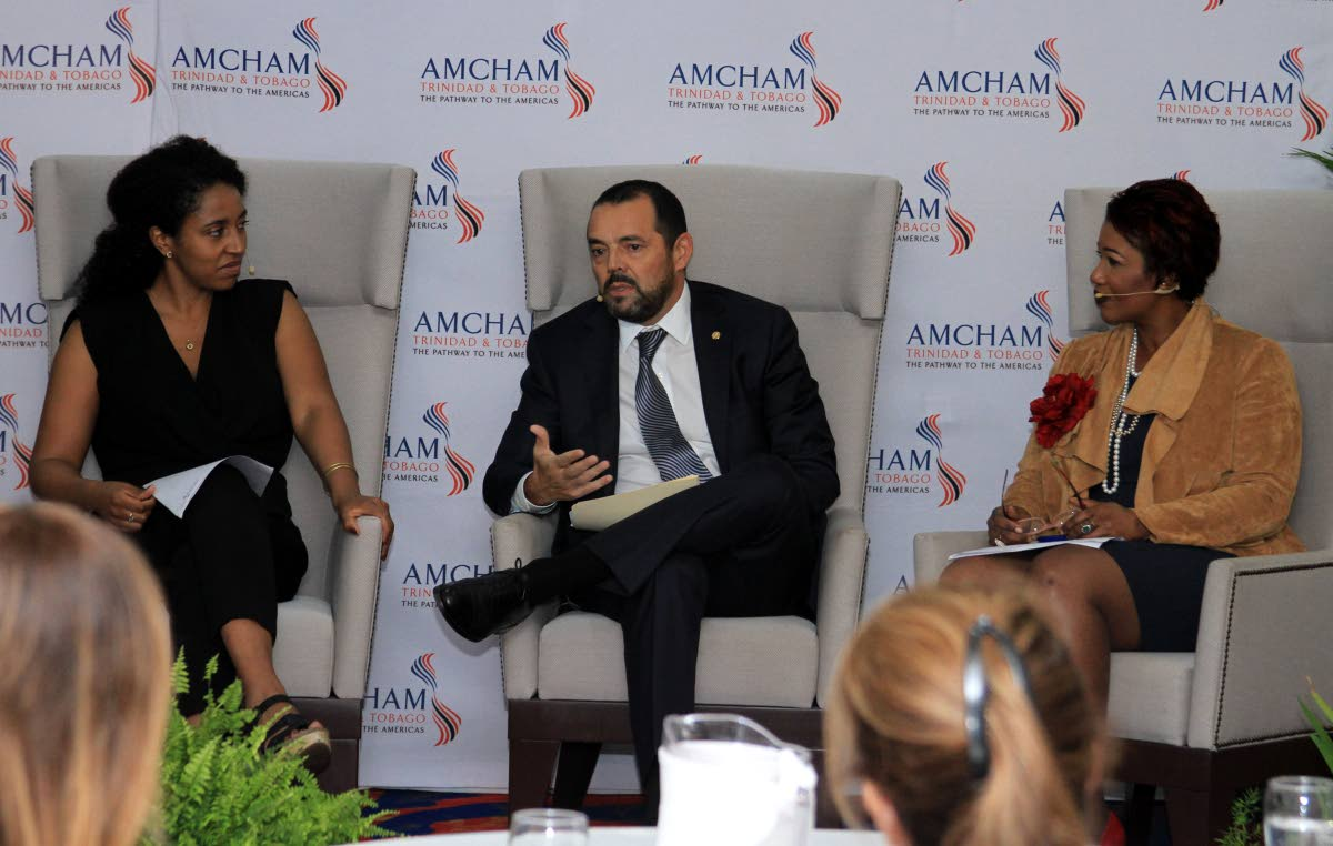 Nestle's market head Anglo Dutch Caribbean, Patricio Torres, centre, speak during the American Chamber of Commerce seminar on business and gender diversity at the Radisson Hotel, Port of Spain on Friday. Also in the photo are head of gender, diversity and inclusion, IDB Invest, Stephanie Oueda Cruz, left, and JMMB chief marketing officer Lisa-Marie Alexander.  PHOTO BY AYANNA KINSALE