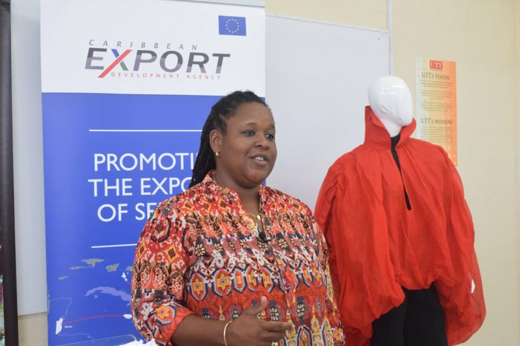 Allyson Francis, Services Specialist, Caribbean Export Development Agency, speaks  at the University of Trinidad and Tobago, John Donaldson Campus at the closing of a two week workshop held for young fashion desginers from around the Caribbean on Friday afternoon.