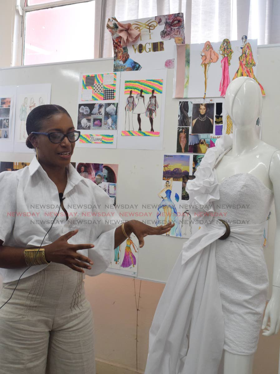 Kimon Baptiste-St Rose talks about her design at the UTT, John Donaldson Campus workshop for fashion desginers from the Caribbean on Friday.