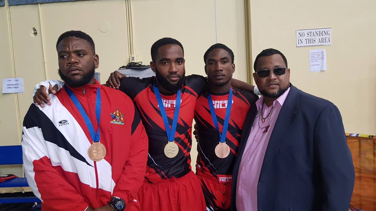 TT MMA Federation president Jason Fraser, right, with national fighters Erland Meloney, Lashawn Sladden and Jeremy Rudolfo at the 2019 Pan Am MMA Championships in Bahamas.