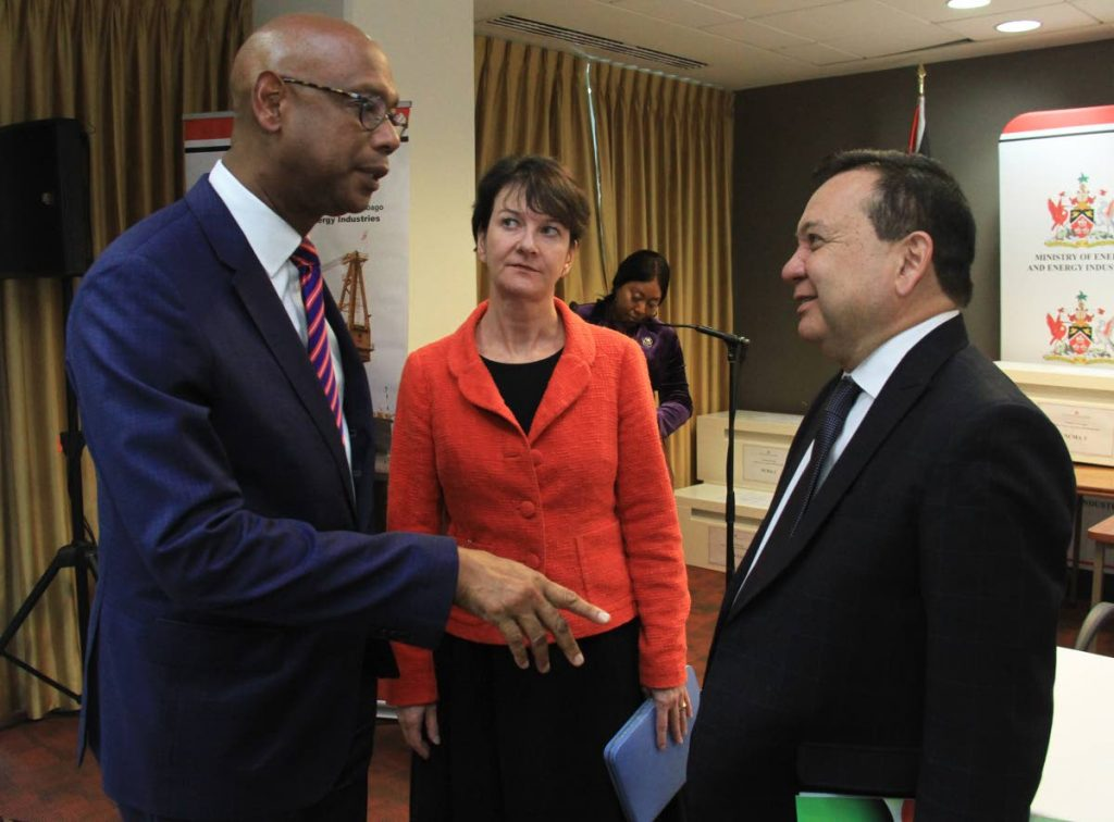 Energy Minister Franklin Khan (right) speaks with Derek Hudson, VP and country chairman for Shell, and BPTT president Claire Fitzpatrick yesterday. PHOTO BY AYANNA KINSALE