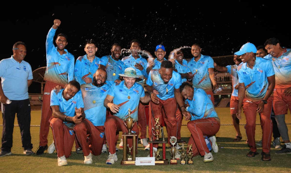 Queen's Park players and staff celebrate their victory in the TTCB Premiership 50-overs final on Sunday evening.