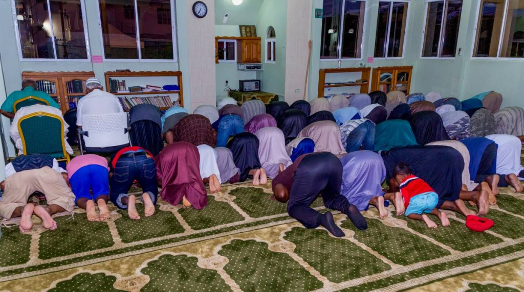 Muslims prayer before they break fast at the Masjid Al Tawbah in Lowlands.