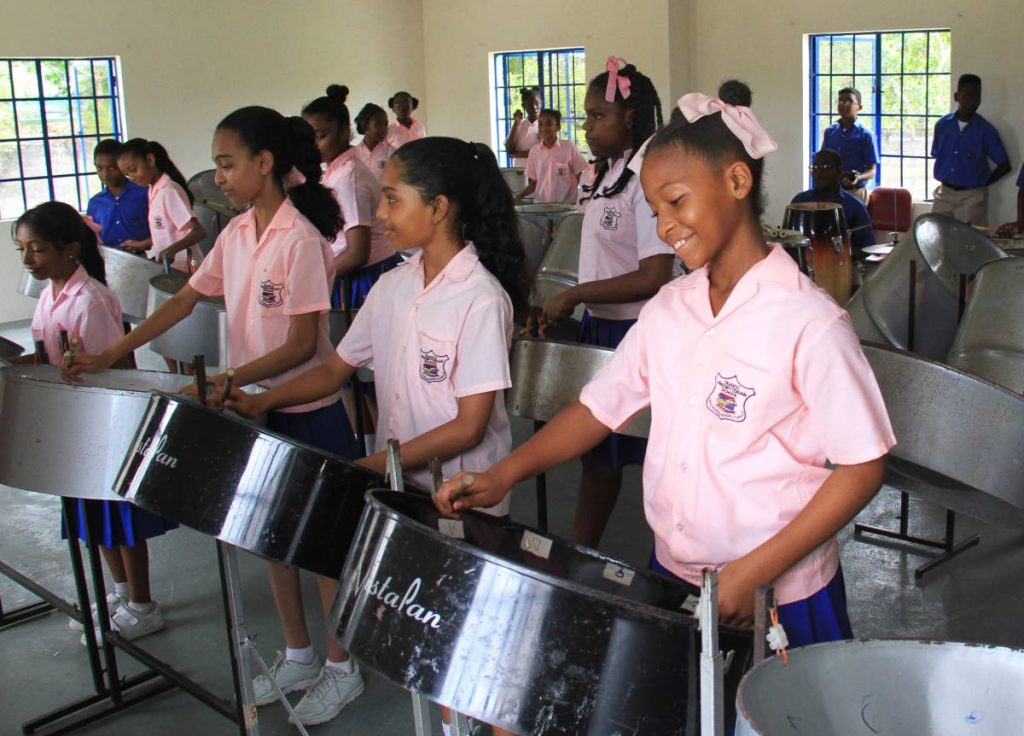 Members of the Guaico Presbyterian Steel Orchestra during rehearsals at their school.    PHTOTO: AYANNA KINSALE