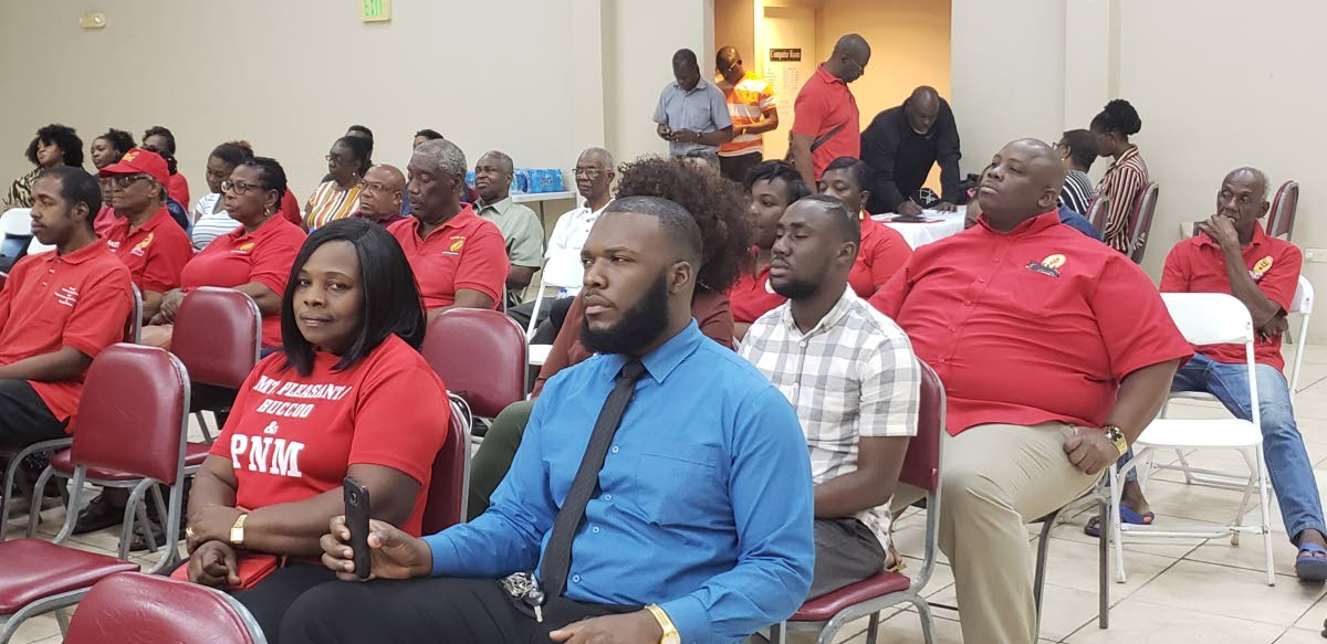 PNM supporters listen to speakers at a PNM Tobago Council meeting on Tuesday.