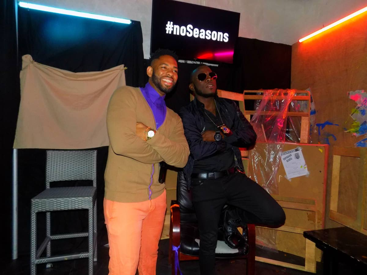 Soca artiste Erphaan Alves, right, poses with radio personality Hans Des Vignes at the premiere of Alves' music video 'Lock On' on Tuesday at Vas Lounge, Woodbrook.