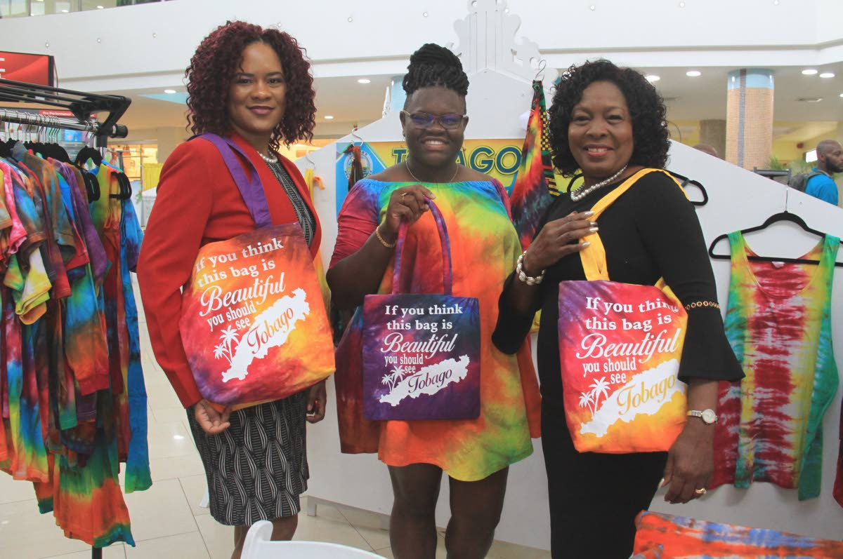 BAG LADIES: Minister of State in the Office of the PM Ayanna Webster-Roy, Sherraine's Tie Dye designer Kishawna Sebro and THA Secretary for Community Development Marslyn Melville-Jack show off hand bags made by Sebro