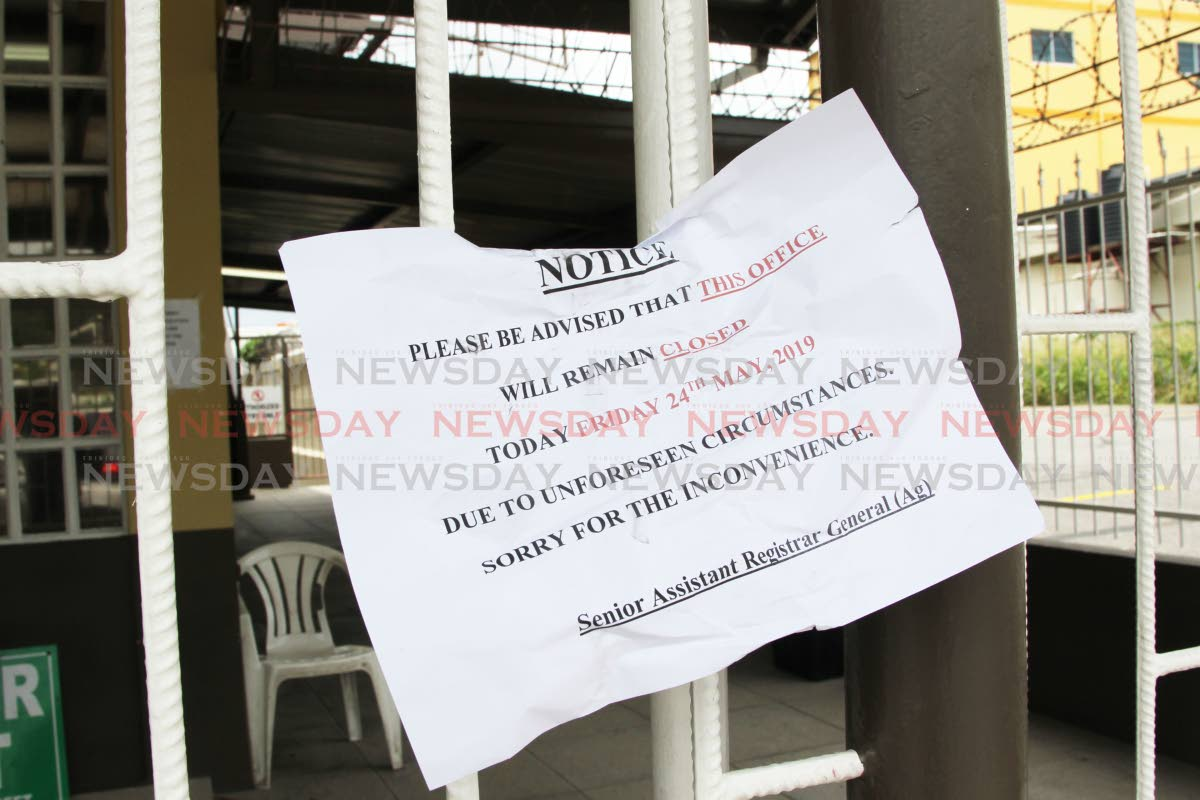 A notice posted outside the closed office of the Ministry of Legal Affairs on Leotaud St, San Fernando, yesterday. PHOTO BY LINCOLN HOLDER