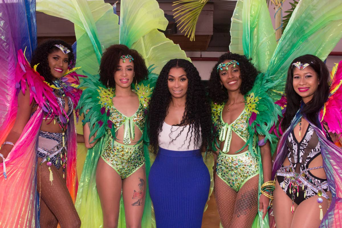 Love and Hip Hop Atlanta star Karlie Redd pose with masqueraders from Lost Tribe's Talent Bank.