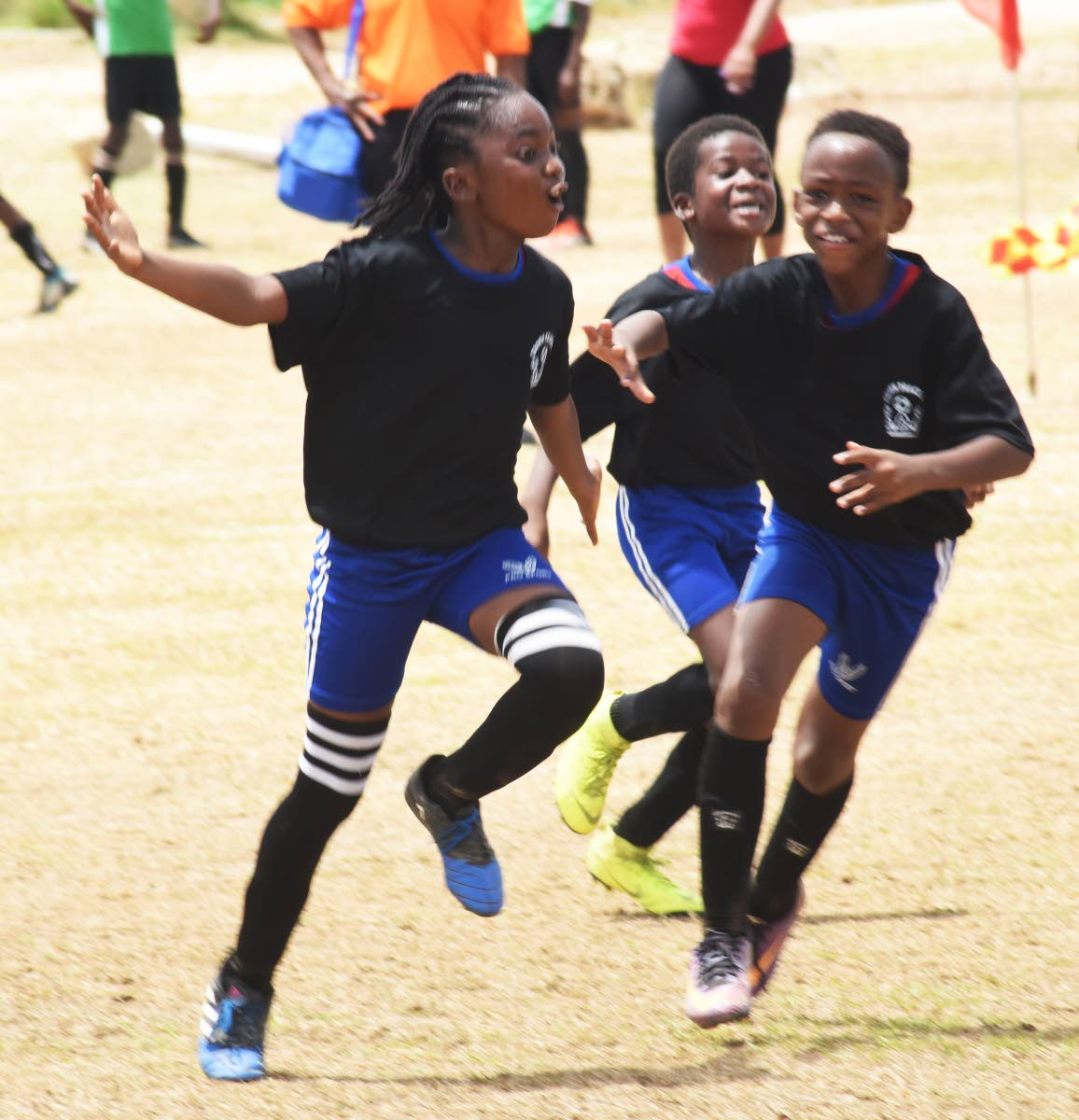 Merimba Melesse of Crown Trace United celebrates after scoring a goal during an  Under-11 match.