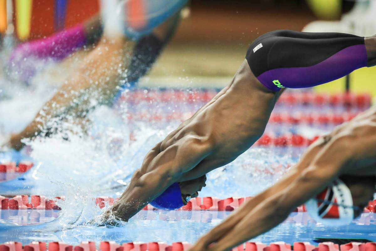 Flying Fish Swim Club's Jeron Thompson enters the pool in the Boys 11 & over 100m freestyle, during the ASATT National Open Long Course Championship 2019 at the National Aqutic Centre, Couva,on Friday.