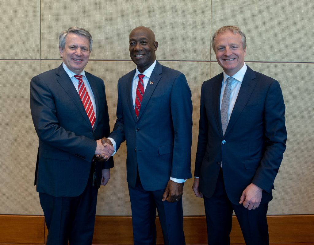 Prime Minister Dr the Honourable Keith Rowley greets Ben van Beurden, Chief Executive Officer of Royal Dutch Shell. To his right is Maarten Wetselaar, Shell's Director Integrated Gas and New Energies. Photo courtesy Office of the Prime Minister