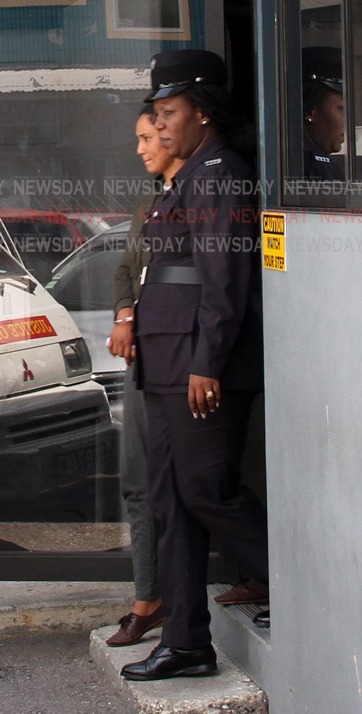 Shazana Hosein 30, of Princess Town is scene leaving the Siparia Magistrate Court with a police officer this morning.