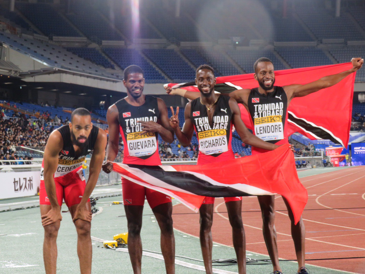 TT's  champion quartet (from left) Machel Cedenio, Asa Guevara, Jereem Richards and Deon Lendore with the national flag after winning the 4x400m final at the IAAF World Relays in Yokohama, Japan today. PHOTO COURTESY IAAF WORLD RELAYS
