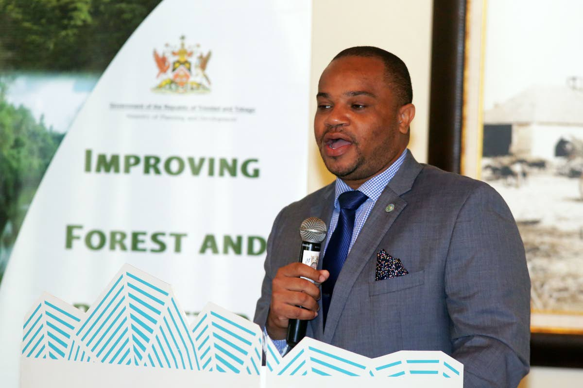 Kwesi Des Vignes, Secretary of Infrastructure, Quarries and the Environment, addresses stakeholders at the Focusing on the Green Economy environmental symposium held last year.
